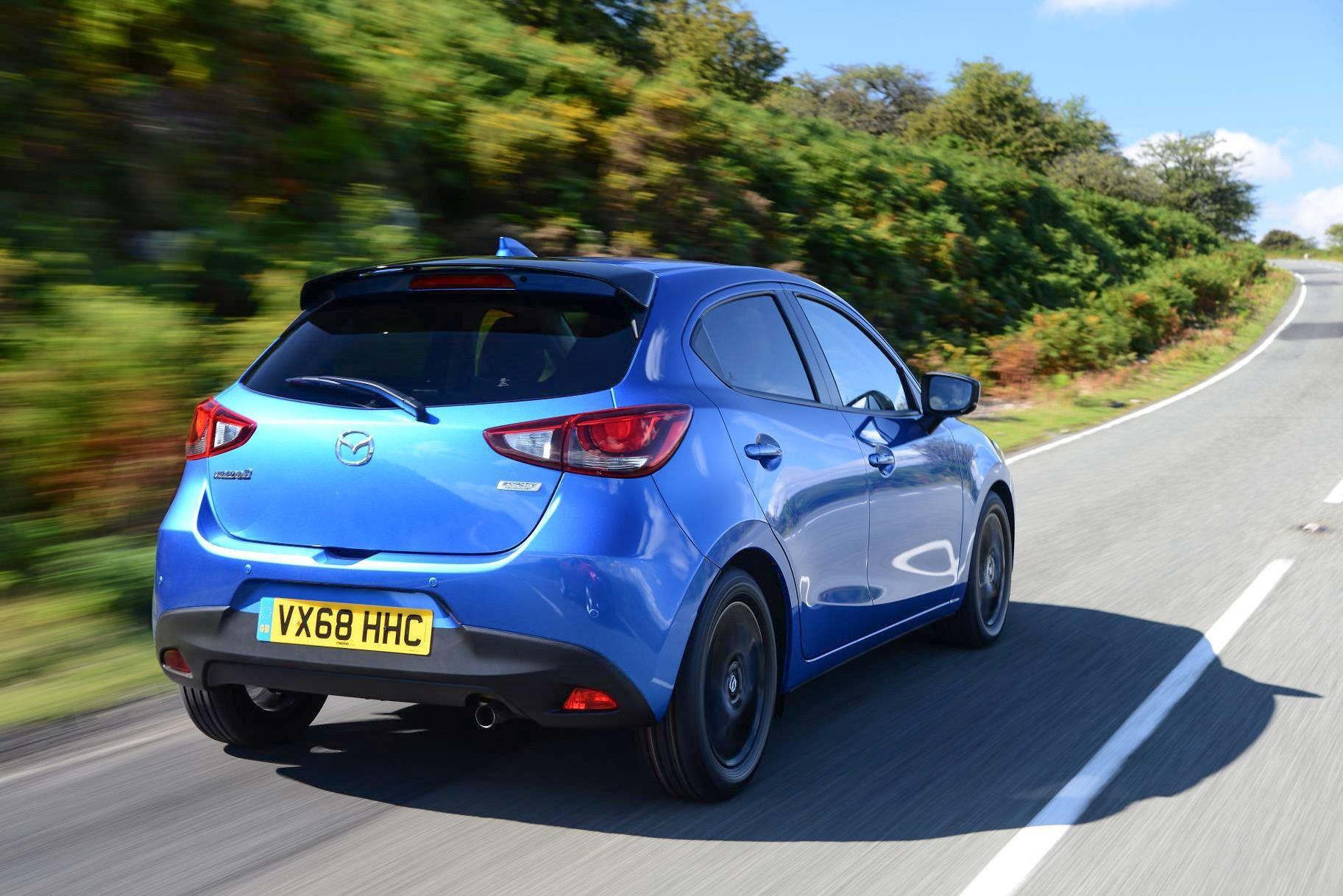 Mazda2 blue on road