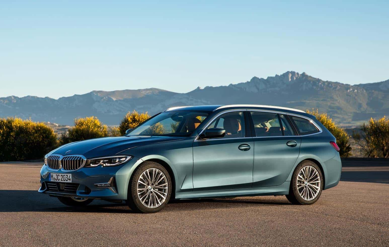 3 series touring front three quarter angle