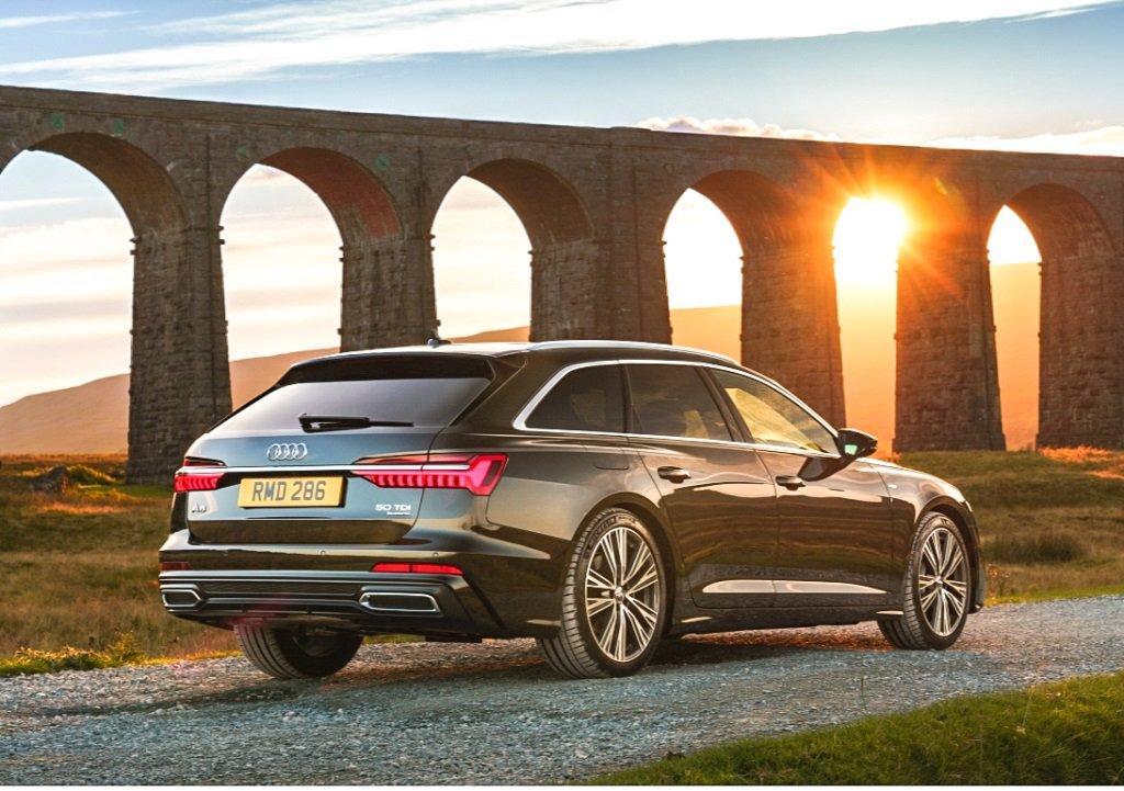 Audi A6 Avant grey sunset viaduct