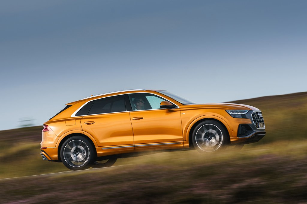 Audi Q8 Moorland tracking shot from side