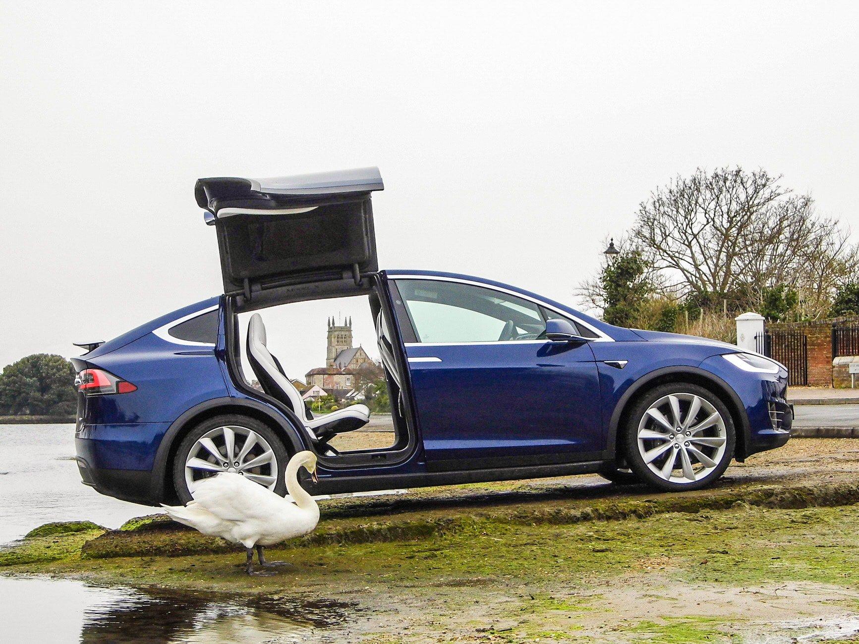 Tesla Model X rear falcon door open.